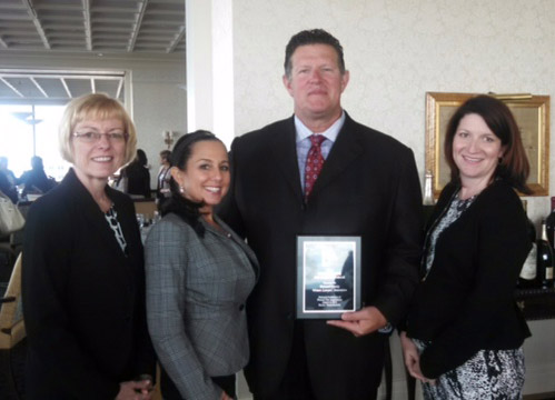 Board Member Rob accepting BCWLA's outstanding member program award from the National Conference of Women's Bar Associations.